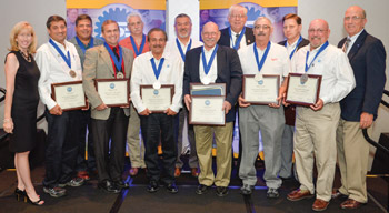 Trish Serratore, left, president of NATEF/AYES, is shown with the 11 instructors recognized at the ASE Industry Education Alliance Instructor Training Conference held recently. Continuing from left: Carl Hader, Marlo Miranda, Thomas Evans, Jasper Adams, Curtis Silver, Bill Robin, Gary Weese, Randy Baker, Robert Leone, Mark Hendricks and Gary Wilfong. On the right in the photo is Chuck Roberts, vice president of NATEF/AYES.