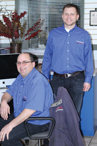 Curt Massoll (seated) and Andy Massoll are both Bosch and ASE-certified technicians and ASE accredited service consultants. Curt founded the business and Andy grew up in it. Andy has served as a technician and service adviser, and is now co-owner and general manager.
