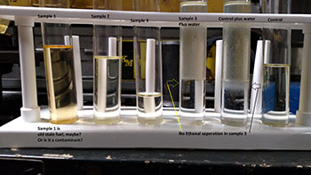 """Using a set of laboratory test tubes, we grabbed fuel samples at different stages of pumping out the fuel tank and included two examples of """"fresh"""" gasoline to serve as the control portion of our experiment."""