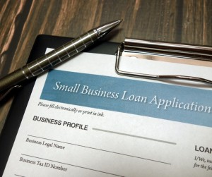 Clipboard With Small Business Loan Application Form And Pen On Desk Picture Id1150028178