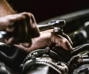 Auto Mechanic Working On Car Engine In Mechanics Garage Repair Picture Id1162856846