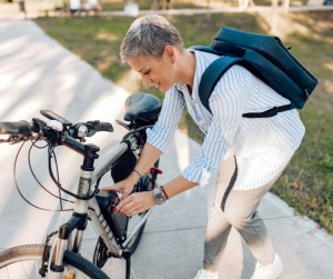 Businesswoman Going To Work By The Electric Bicycle Picture Id1276091858