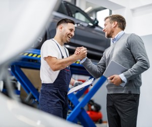 Happy Auto Mechanic And His Manager Greeting In A Repair Shop Picture Id1248192306